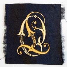 Embleem met monogram OL - Textielmuseum (registratiefoto), onbekend