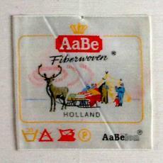 Textieletiket AaBe fiberwoven - Textielmuseum (registratiefoto), Van Engelen & Evers (Heeze), Koninklijke AaBe Wollenstoffen- en Wollendekenfabrieken (Tilburg)