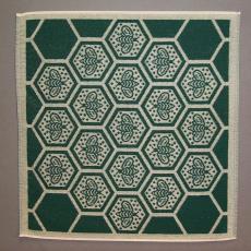 Keukenhanddoek met 'bij'-motief, 1995 - Mariëtte Wolbert, Elias Jorzolino (Neede), Textielmuseum (registratiefoto), De Bijenkorf (Den Haag)